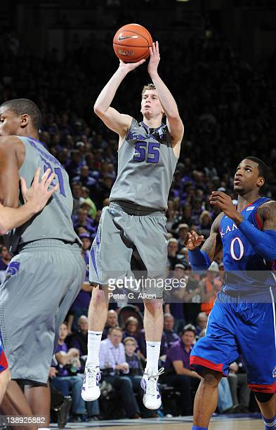 Guard Will Spradling of the Kansas State Wildcats scores past forward Thomas Robinson of the Kansas Jayhawks during the second half on February 13...