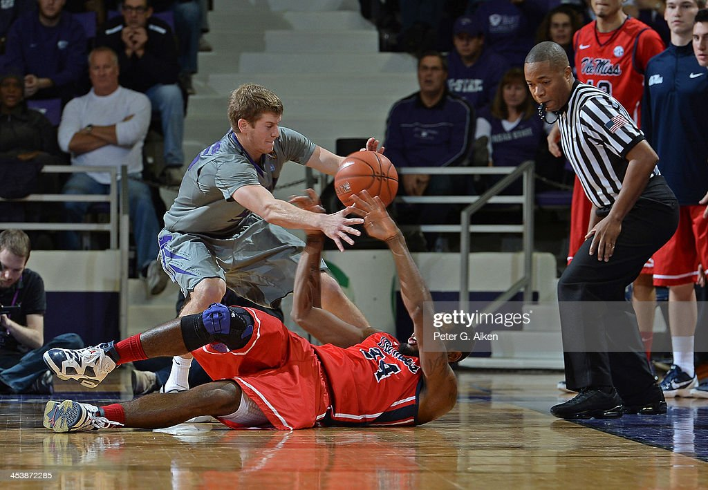 Guard Will Spradling #55 of the Kansas State Wildcats scrambles for the ball with forward Aaron Jones #34 of the Mississippi Rebels during the second half on December 5, 2013 at Bramlage Coliseum in Manhattan, Kansas. Kansas State won 61-58.