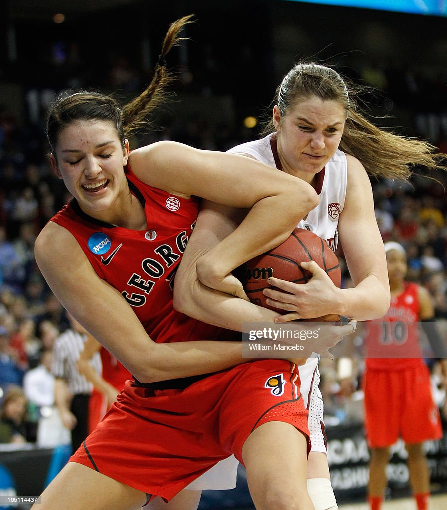 Guard/forward Anne Marie Armstrong #3 of the Georgia Lady Bulldogs and guard Sara James #21 of the Stanford Cardinal battle for possession of the ball in the second half during the NCAA Division I Women's Basketball Regional Championship at Spokane Arena on March 30, 2013 in Spokane, Washington.