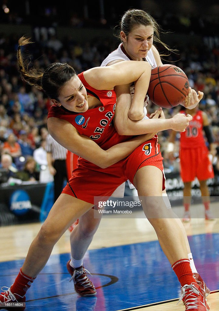 Guard/forward Anne Marie Armstrong #3 of the Georgia Lady Bulldogs and guard Sara James #21 of the Stanford Cardinal battle for possession of the ball in the second half during the NCAA Division I Women's Basketball Regional Championship at Spokane Arena on March 30, 2013 in Spokane, Washington. The Lady Bulldogs defeated the Cardinal 61-59.