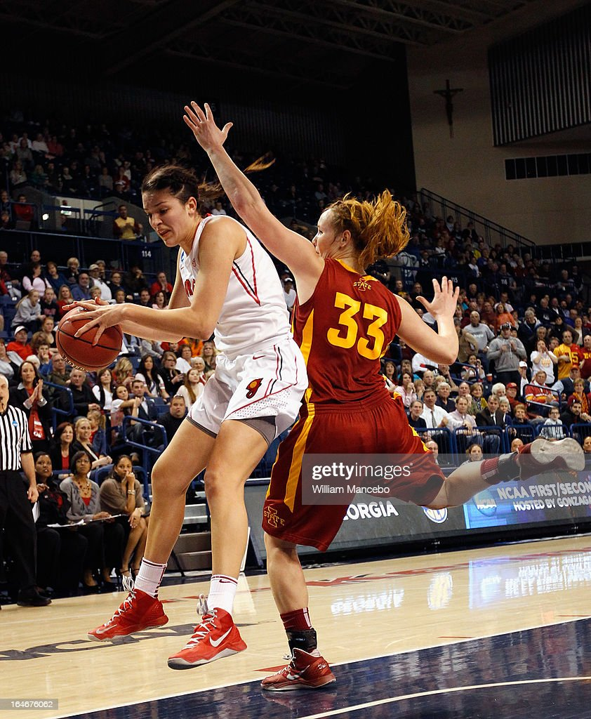 Guard/forward Anne Marie Armstrong #3 of the Georgia Lady Bulldogs battles for control of the ball against forward Chelsea Poppens #33 of the Iowa State Cyclones late in the game during the second round of the 2013 NCAA Women's Basketball Tournament at McCarthey Athletic Center on March 25, 2013 in Spokane, Washington. The Lady Bulldogs defeated the Cyclones 65-60.