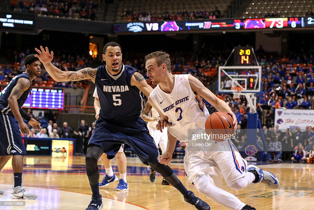 Guard/forward Anthony Drmic of the Boise State Broncos drives the baseline against the defense of forward Kaileb Rodriguez of the Nevada Wolf Pack...