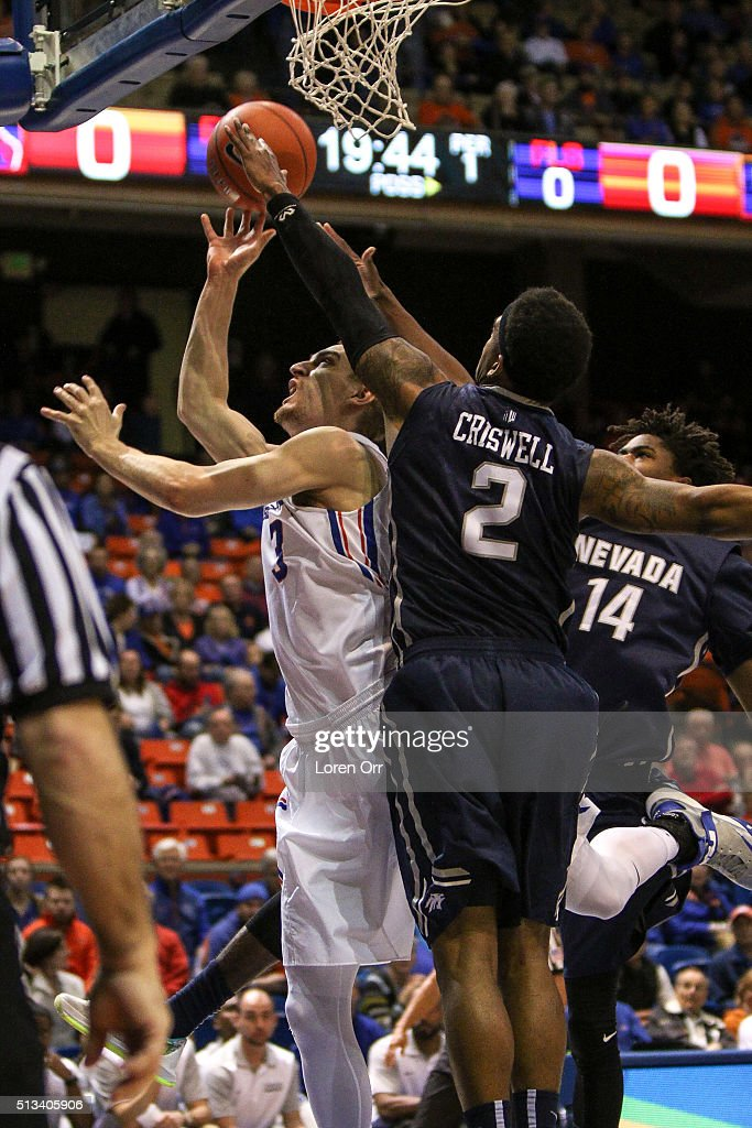 Guard/forward Anthony Drmic of the Boise State Broncos drives to the basket through the defense of guard Tyron Criswell and guard Lindsey Drew of the...