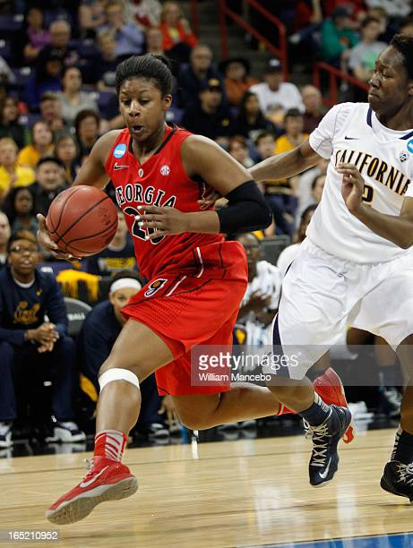 Guard/forward Shacobia Barbee of the Georgia Lady Bulldogs plays against guard Afure Jemerigbe of the California Golden Bears in the first half...