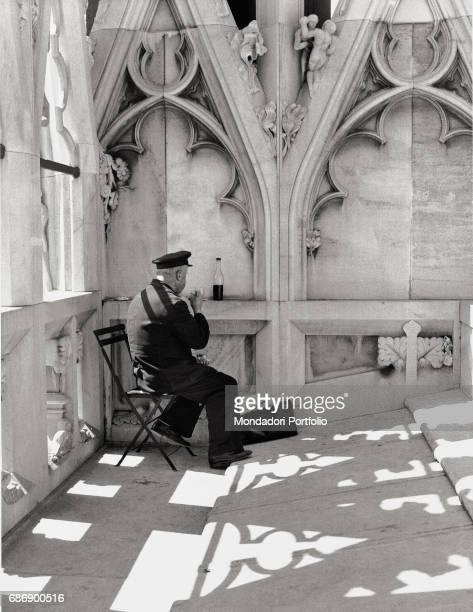 Guardian having breakfast on the roof of the Duomo This picture is taken from the monography 'Mario De Biasi Il mio sogno Š qui' curated by Enrica...
