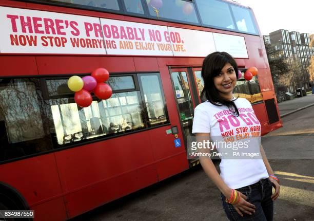 Guardian journalist Ariane Sherine poses beside a bus displaying an atheist message in Kensington Gardens London Brainchild of Ariane Sherine the...