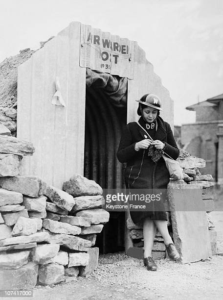 Guardian Woman Guarding The Entrance Of An Air Raid Shelter While Knitting In London