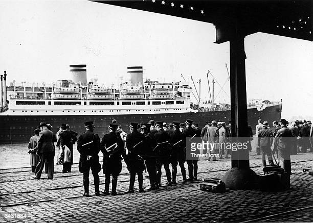 Gendarmes and plainclothes police guard the St Louis as it docks at the Belgian port of Antwerp with its cargo of GermanJewish refugees after being...