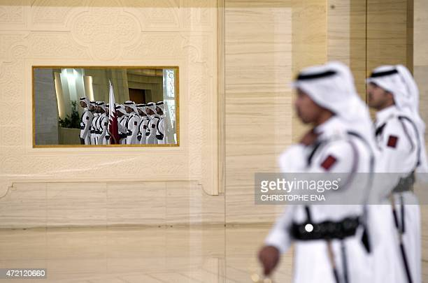 Guards attend a cermony with French President Francois Hollande and Qatar's Emir Sheikh Tamim bin Hamad alThani at the Diwan Palace in Doha on May 4...