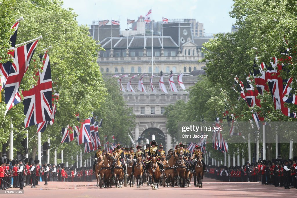 Guards march down the Mall towards Buckingham Palace during the annual Trooping the Colour Ceremony on June 15, 2013 in London, England. Today's ceremony which marks the Queens official birthday will not be attended by Prince Philip the Duke of Edinburgh as he recuperates from abdominal surgery and will also be The Duchess of Cambridge's last public engagement before her baby is due to be born next month.