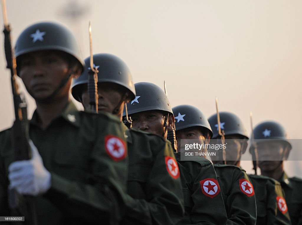 Guards of honor march during a ceremony marking Myanmar's 66th Union Day anniversary in Yangon on February 12, 2013. AFP PHOTO/ Soe Than WIN
