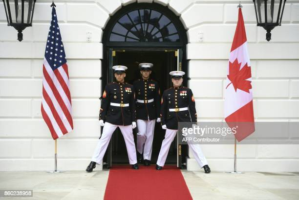 Guards of honor step outside the South Portico of the White House in Washington DC October 11 2017 during a welcoming ceremony by US President Donald...