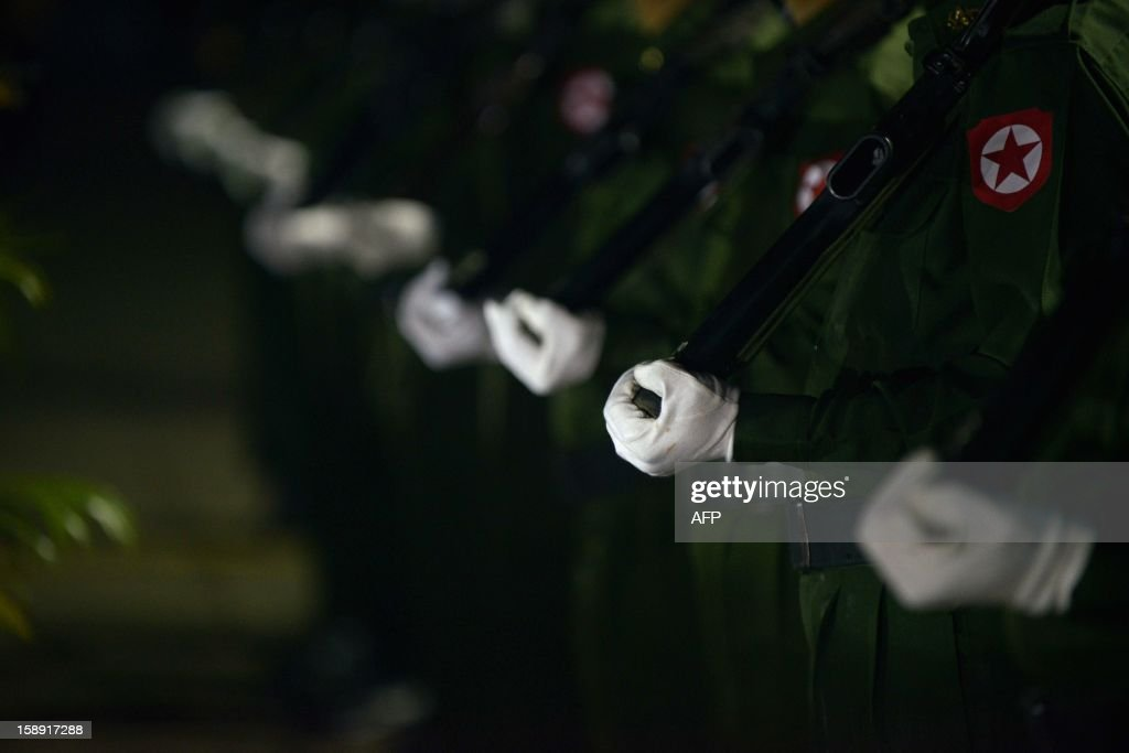 Guards of honour stand at attention during a flag-raising ceremony to mark of Myanmar's 65th Independence Day at the People's Square near Shwedagon pagoda in Yangon January 4, 2013. Myanmar, formerly known as Burma, gained independence from Britain on January 4, 1948. AFP PHOTO / YE AUNG THU