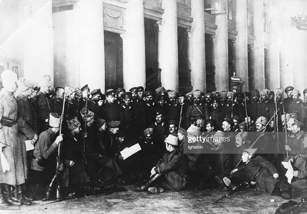 Guards of the Tavrichesky Palace listening to the reading of Izvestia in Petrograd, read by Bolsheviks to convince them of the rights of their revolutionary policies.