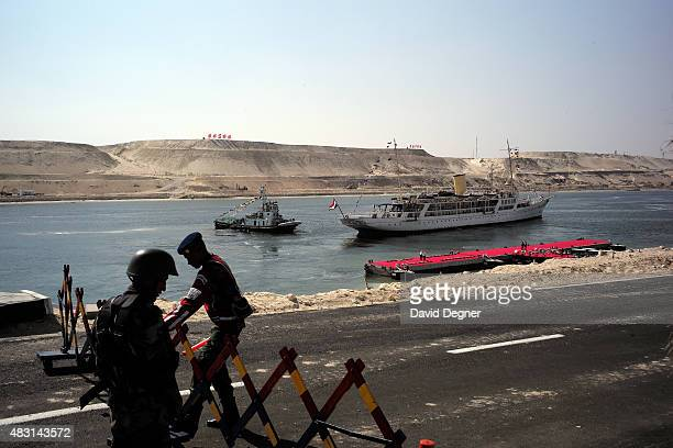 Guards open a gate as the Mahrousa pulls away from the dock during the opening ceremony of the new Suez Canal expansion including a new 35km channel...