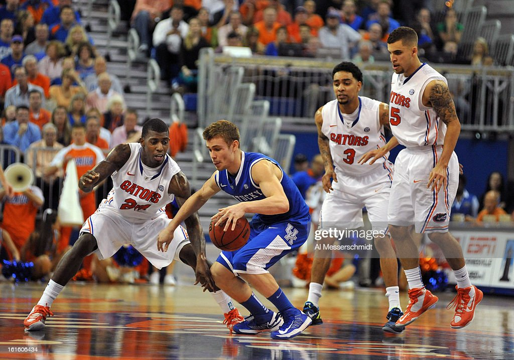 Guards Scottie Wilbekin #5, Mike Rosario #3 and Casey Prather #24 of the Florida Gators surround guard Jarrod Polson #5 of the Kentucky Wildcats February 12, 2013 at Stephen C. O'Connell Center in Gainesville, Florida.