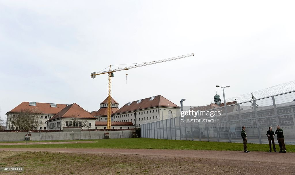 Guards stand at a football field of the Landsberg prison in Landsberg southern Germany on March 31 2014 The former FC Bayern Munich President Uli...