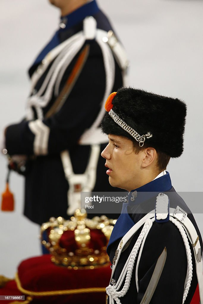 Guards stand beside the regalia (Crown, Sceptre, Globus Cruciger and Sword of State) during the inauguration of HM King Willem-Alexander of the Netherlands and HM Queen Maxima of the Netherlands at New Church on April 30, 2013 in Amsterdam, Netherlands.