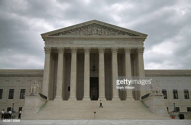 Guards stand in front of the Supreme Court Building August 20 2014 in Washington DC Today the high court blocked gay and lesbian couples from...