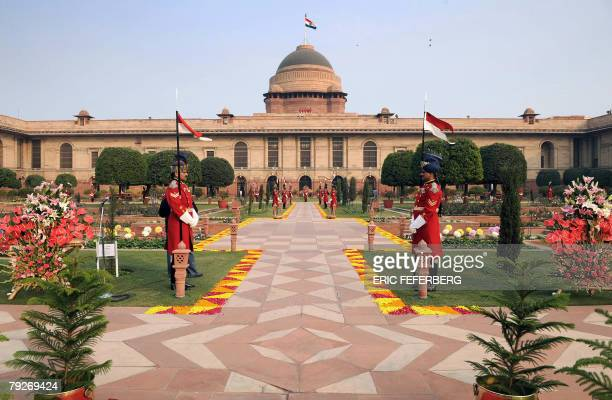 Guards stand in the Mughal gardens surrounding Rashtrapati Bhavan the Indian Presidential Palace during India's 59th Republic Day celebrations in New...
