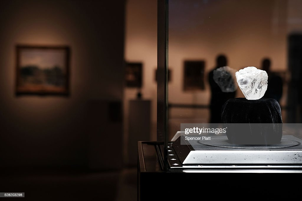 Guards stand next to the 1109-carat rough Lesedi La Rona diamond, the biggest rough diamond discovered in more than a century, at Sotheby's on May 04, 2016 in New York City. The stone was found by Lucara Diamond Corp. last year at its Karowe mine in Botswana. The diamond, which is nearly the size of a tennis ball at 66.4 x 55 x 42 mm and is believed to be about 2.5 billion to 3 billion years old, was named 'Our Light' in the local Tswana language. Lesedi La Rona will be offered at auction in London on June 29 and be on display at Sotheby's New York. The diamond could sell for $70 million or more.