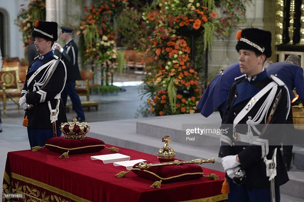 Guards watch over the regalia (Crown, Sceptre, Globus Cruciger and Sword of State) at the credence-table prior to the inauguration of HM King Willem Alexander of the Netherlands and HRH Princess Beatrix of the Netherlands at New Church on April 30, 2013 in Amsterdam, Netherlands.