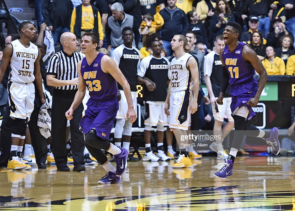 Guards Wes Washpun #11 and Wyatt Lohaus #33 of the Northern Iowa Panthers celebrate after beating the Wichita State Shockers 53-50 on February 13, 2016 at Charles Koch Arena in Wichita, Kansas.