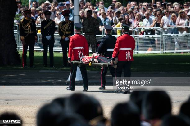 Guardsman is carried off on a stretcher after fainting during the annual Trooping The Colour parade in Horse Guards Parade on June 17 2017 in London...