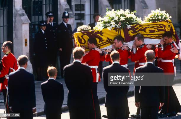 Guardsmen of the Prince of Wales Company of the Welsh Guards carry Diana's coffin into Westminster Abbey London England at the funeral of Diana...