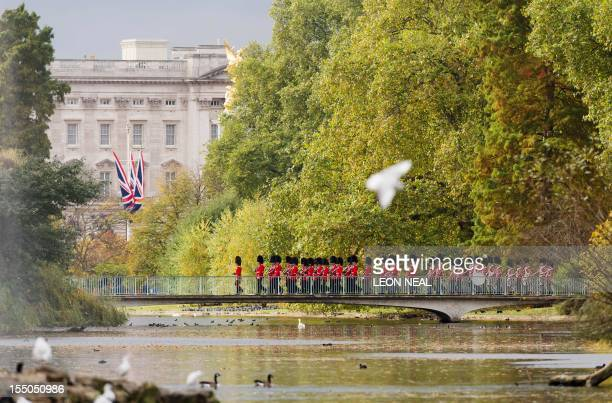 Guardsmen walk through St James Park in front of Buckingham Palace after the official welcome for Indonesian President Susilo Bambang Yudhoyono in...