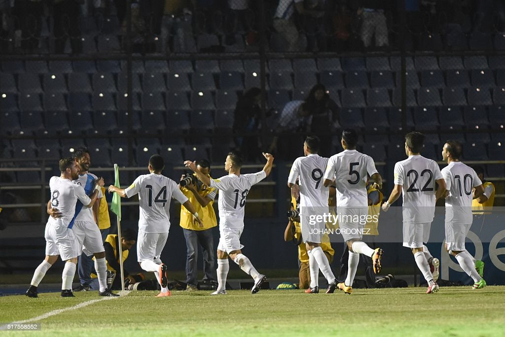 Guatamalan players celebrate after scoring against the USA during their Russia 2018 FIFA World Cup North and Central America Qualifiers' football...