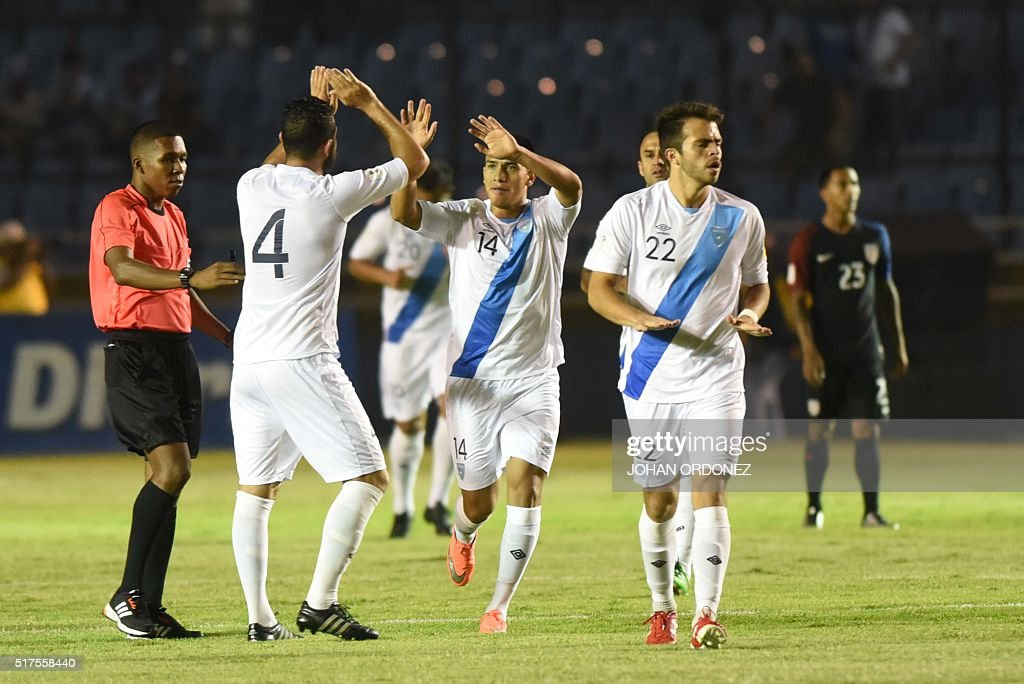 Guatamala's Hamilton Lopez congratulates his teammate Rafael Morales after scoring against USA during their Russia 2018 FIFA World Cup North and...