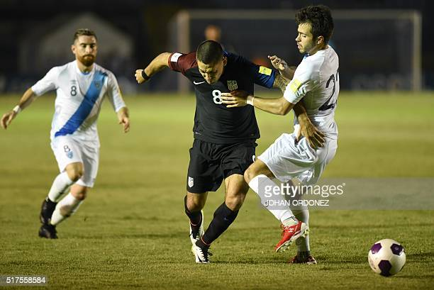 Guatamala's Rodrigo Saravia vies for the ball with USA's Clint Dempsey during their Russia 2018 FIFA World Cup North and Central America Qualifiers'...