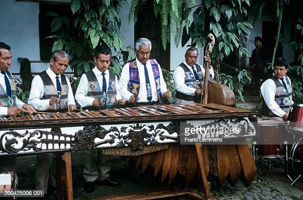 Guatemala, Antigua, male musicians playing marimba