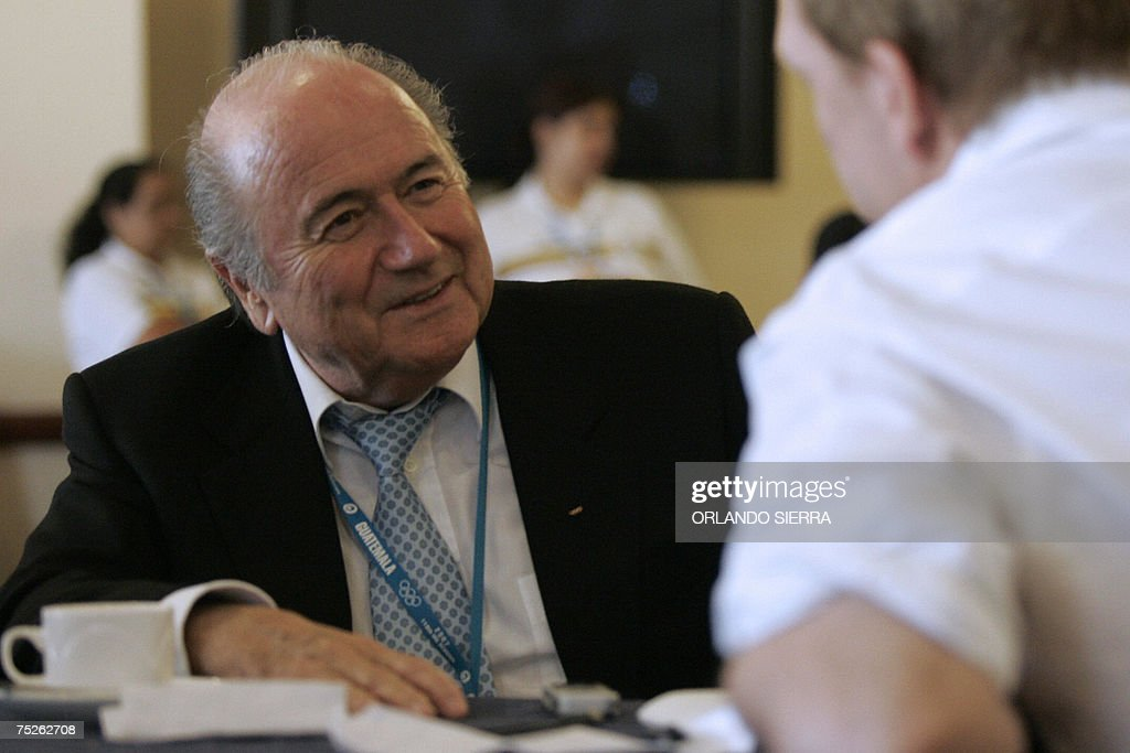 FIFA's president Joseph Blatter speaks with an unidentified man at the end of the 119th International Olympic Committee Session on July 7th, 2007 in Guatemala City. AFP PHOTO/Orlando SIERRA