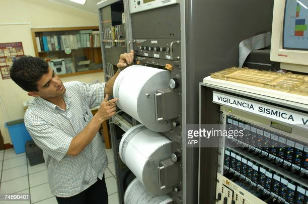 Guatemalan seismologist Luis Alberto Ortega inspects his intruments 13 June 2007 in Guatemala City after a seism 54 in the Richter scale hit...