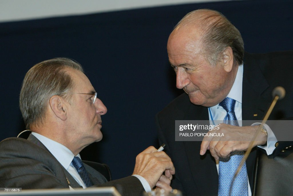 International Olympic Committee President Jacques Rogge (L) speaks with FIFA's president Swiss Joseph Blatter (R) at the beginning of the third meeting of the 119th International Olympic Committee Session on July, 06th, 2007 in Guatemala City. AFP PHOTO/Pablo PORCIUNCULA