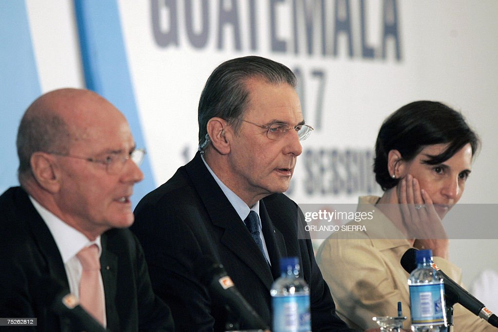 Kevan Gosper, chairman of the International Olympic Committee; Jacques Rogge, IOC's president; and Giselle Davies, IOC's Communications Director, give a press conference at the end of the 119th IOC Session in Guatemala City, on July 7th, 2007. AFP PHOTO/Orlando SIERRA