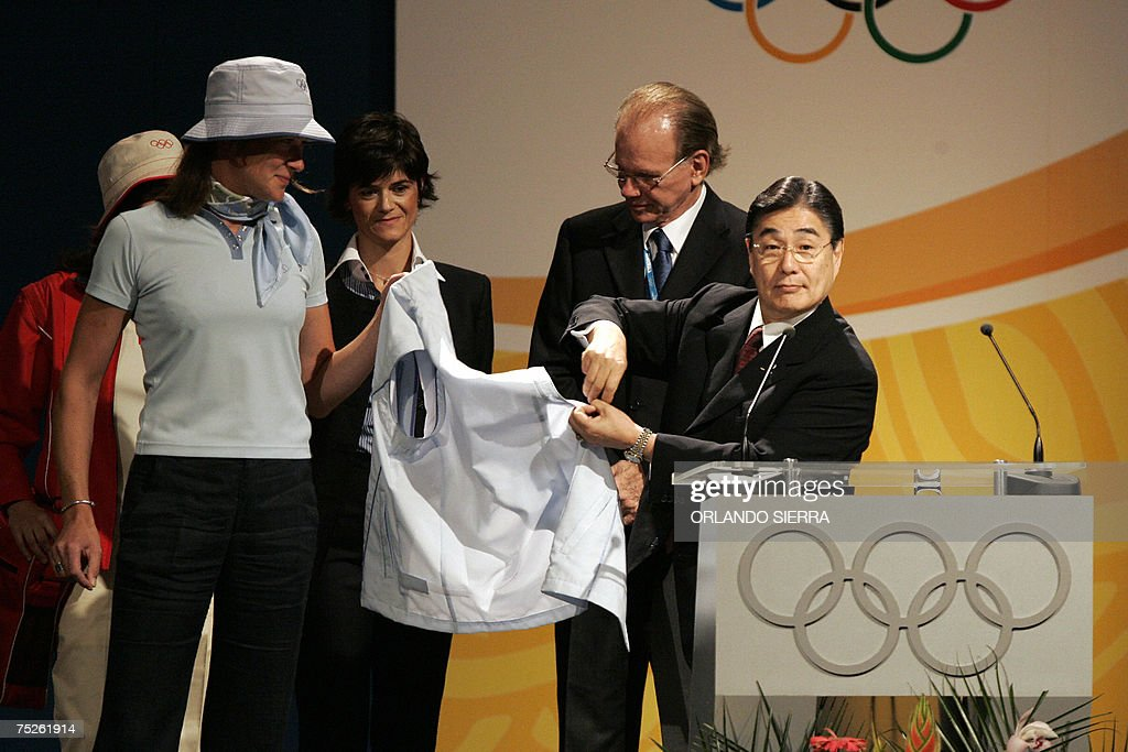 Masato Mizuno (R), chairman of Mizuno Corporation, shows the official clothing for the 2008 Beijing Olympic Games, at the end of the 119th International Olympic Committee Session in Guatemala City, on July, 07th, 2007. AFP PHOTO/Orlando SIERRA