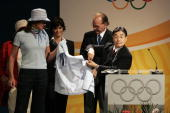 Masato Mizuno chairman of Mizuno Corporation shows the official clothing for the 2008 Beijing Olympic Games at the end of the 119th International...