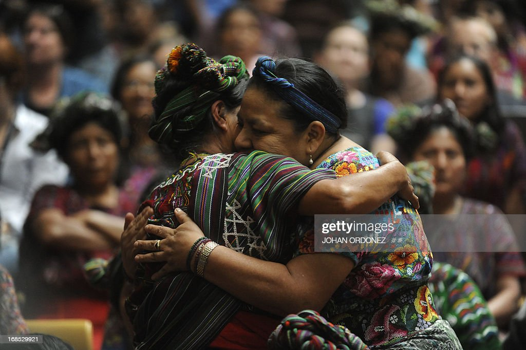 Guatemalan 1992 Nobel Peace Prize laureate Rigoberta Menchu (R) hugs a relative of a victim of Guatemala's civil war during the trial against former Guatemalan de facto President (1982-1983), retired General Jose Efrain Rios Montt, on charges of genocide committed during his regime, in Guatemala City, on May 10, 2013. Rios Montt was found guilty of genocide and war crimes on Friday in a landmark ruling stemming from massacres of indigenous people in his country's long civil war. Rios Montt thus became the first Latin American convicted of trying to exterminate an entire group of people in a brief but particularly gruesome stretch of a war that started in 1960, lasted 36 years and left around 200,000 people dead or missing. AFP PHOTO / Johan ORDONEZ