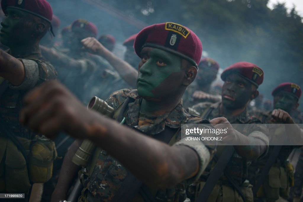 Guatemalan Army's Kaibil elite unit personnel are seen during Army Day celebrations in Guatemala City on June 30, 2013. AFP PHOTO/Johan ORDONEZ