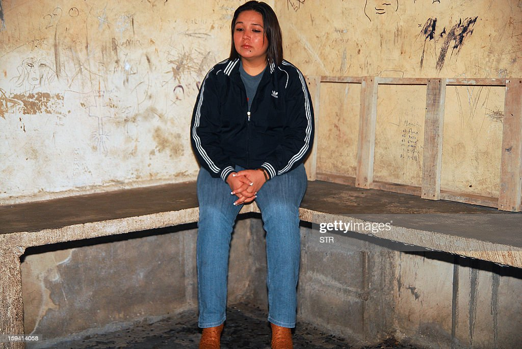 Guatemalan deputy Leslie Elisa Bueso of the Union of National Change party sits in a cell in San Pedro Sula, 180 kms north off Tegucigalpa, on January 13, 2013. Bueso was detained alongside her husband and four bodyguards, for carrying numerous guns without the proper permits.