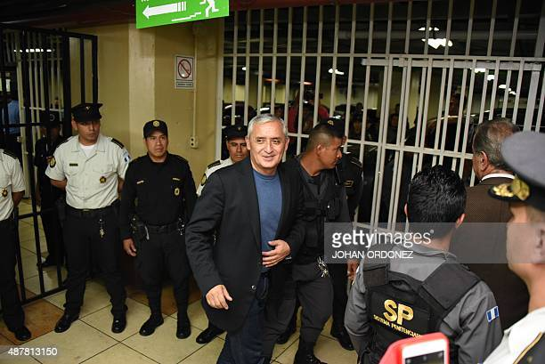Guatemalan expresident Otto Perez arrested on corruption charges smiles after a hearing in a court in Guatemala City on September 11 2015 Perez...