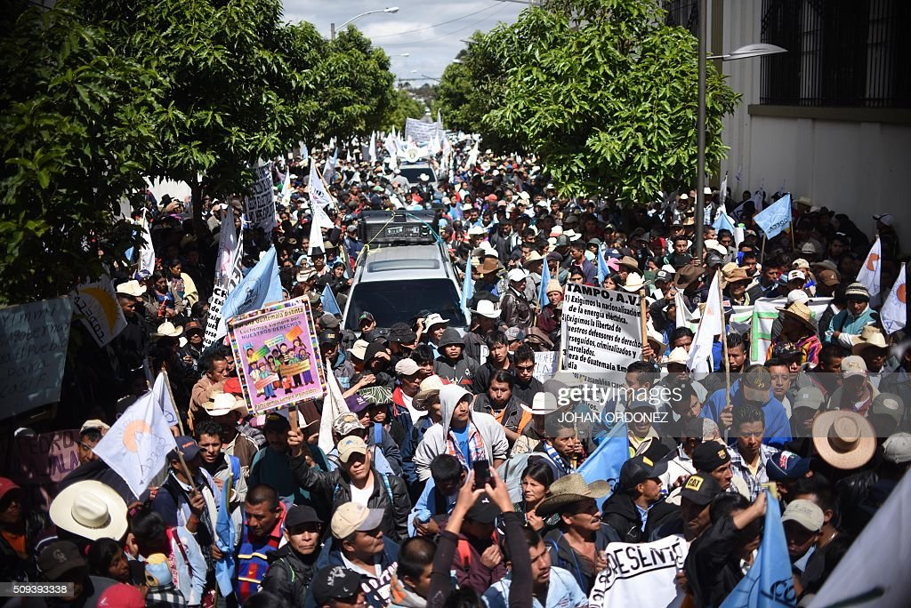 Guatemalan farmers take part in a protest in Guatemala City on February 10, 2016. Thousands of farmers marched Wednesday along the streets of the capital to demand the government of Jimmy Morales to fight poverty, to nationalize energy and to stop projects that plunder natural resources. AFP PHOTO / Johan ORDONEZ / AFP / JOHAN ORDONEZ