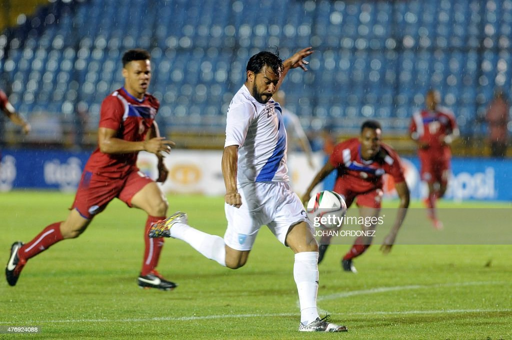 Guatemalan footballer Carlos Ruiz shoots during a CONCACAF qualifying match against Bermuda for the Russia 2018 FIFA World Cup at the Mateo Flores...