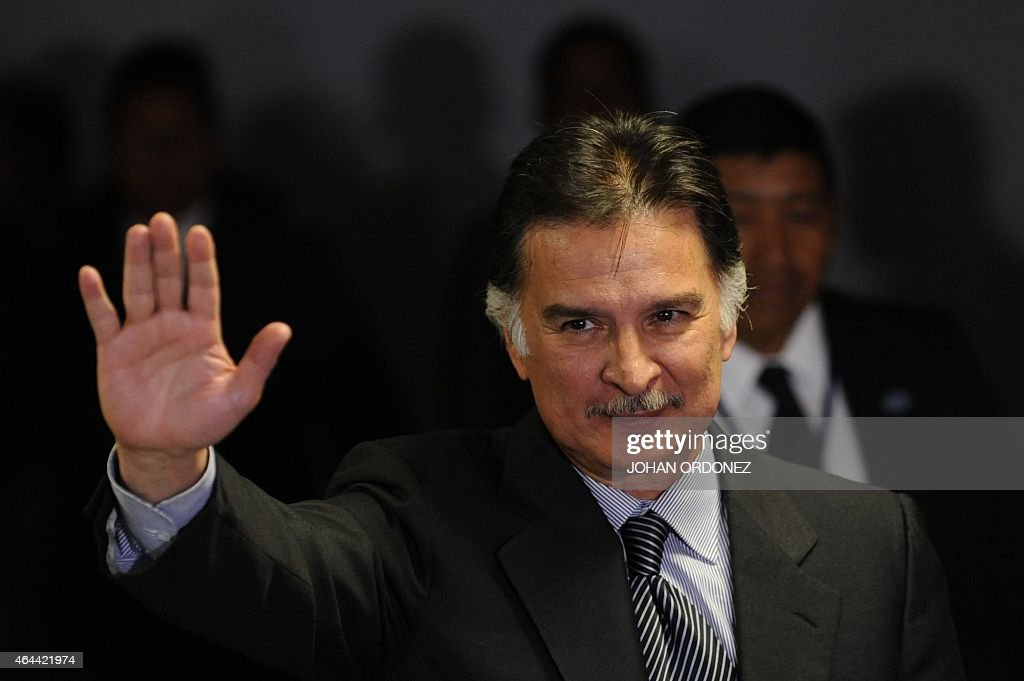 Guatemalan former President <a gi-track='captionPersonalityLinkClicked' href=/galleries/search?phrase=Alfonso+Portillo&family=editorial&specificpeople=235376 ng-click='$event.stopPropagation()'>Alfonso Portillo</a> greets journalists before a press conference at La Aurora international airport in Guatemala City on February 25, 2015. Portillo, was released from prison in the United States and returned to Guatemala, after he served a sentence for taking over USD 2.5 million in bribes from Taiwan.