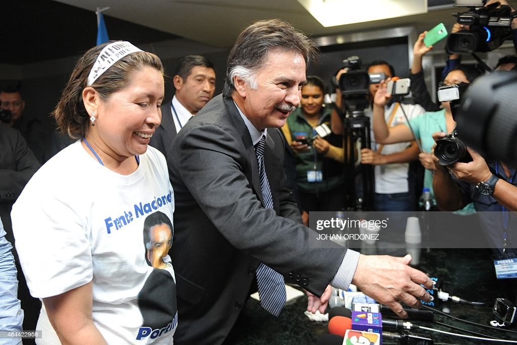 Guatemalan former President <a gi-track='captionPersonalityLinkClicked' href=/galleries/search?phrase=Alfonso+Portillo&family=editorial&specificpeople=235376 ng-click='$event.stopPropagation()'>Alfonso Portillo</a> (R) shakes hands with journalists after a press conference at La Aurora international airport in Guatemala City on February 25, 2015. Portillo, was released from prison in the United States and returned to Guatemala, after he served a sentence for taking over USD 2.5 million in bribes from Taiwan.