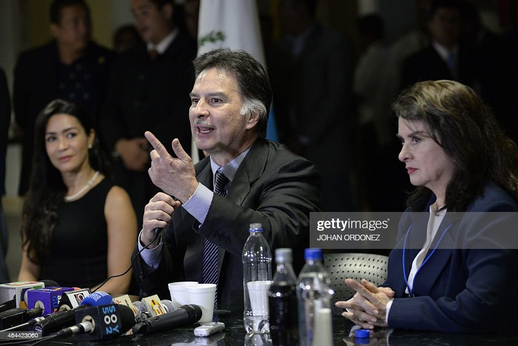 Guatemalan former President <a gi-track='captionPersonalityLinkClicked' href=/galleries/search?phrase=Alfonso+Portillo&family=editorial&specificpeople=235376 ng-click='$event.stopPropagation()'>Alfonso Portillo</a> (C) speaks during a press conference as his ex-wife Evelyn Morataya (L) and sister Enma Portillo look on at La Aurora international airport in Guatemala City on February 25, 2015. Portillo, was released from prison in the United States and returned to Guatemala, after he served a sentence for taking over USD 2.5 million in bribes from Taiwan.