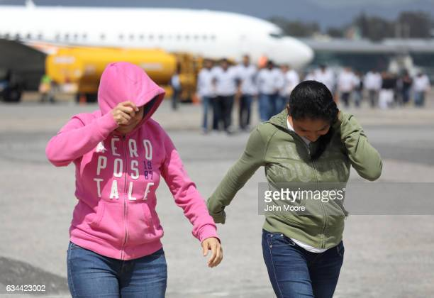 Guatemalan immigrants deported from the United States arrive on a ICE deportation flight on February 9 2017 in Guatemala City Guatemala The charter...